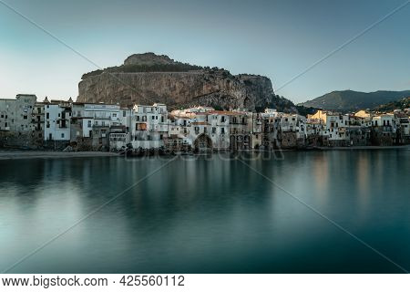 Sunrise In Harbor Of Cefalu, Sicily, Italy, Old Town Panoramic View With Colorful Waterfront Houses,