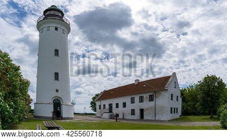 Stevns Klint, Denmark - 12 June, 2021: View Of The Stevns Lighthouse On The East Coast Of Denmark On