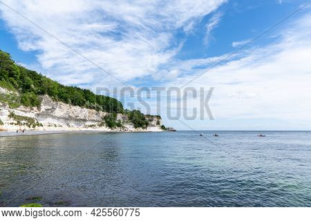 Hojerup, Denmark - 12 June, 2021: Beautiful Ocean Landscape With Steep White Chalkstone Cliffs And F