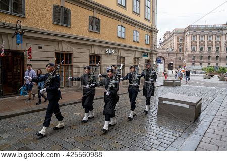 Stockholm, Sweden - 23 June, 2021: Guards Marching To Shift Change For Watch Duty At The Royal Palac
