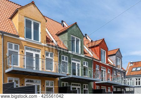 Svendborg, Denmark - 10 June, 2021: Modern Colorful Wooden Row Houses With Balconies And Separated P