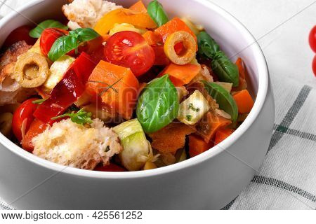 Salad With Baked Vegetables, Croutons, Olives, Capers, Cherry Tomatoes And Olive Oil Served In The G