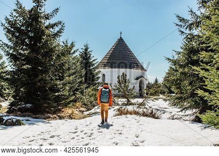 Backpacker At Baroque Chapel Of The Visitation Of The Virgin Mary,kunstat Chapel, Located In Eagle M