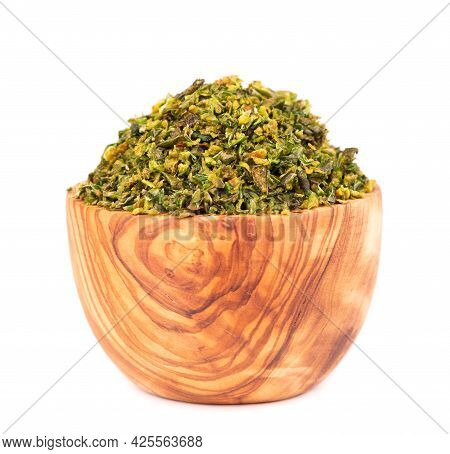 Dried Green Paprika Flakes With Seeds In Olive Bowl, Isolated On White Background. Chopped Jalapeno,