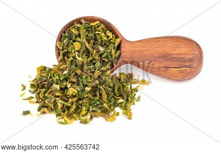 Dried Green Paprika Flakes With Seeds In Wooden Spoon, Isolated On White Background. Chopped Jalapen