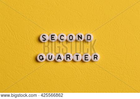 Alphabet Letters With Text Second Quarter Isolated On Yellow Background