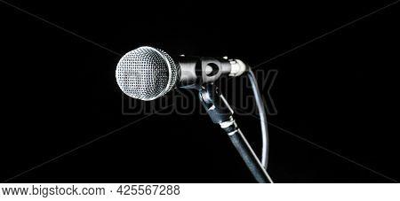 Microphone, Mic, Karaoke, Concert, Voice Music. Closeup Microphone. Vocal Audio Mic On A Bleck Backg