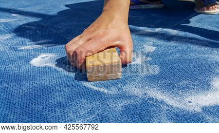 A Woman's Hand Washes The Carpet With A Soap. Hand Wash. Blue Carpet. A Housewife Works At Home. Dry