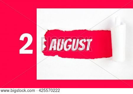 August 2nd. Day 2 Of Month, Calendar Date. Red Hole In The White Paper With Torn Sides With Calendar