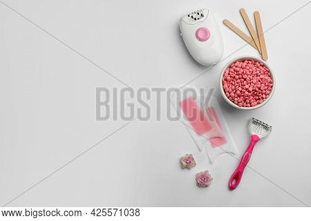 Set Of Epilation Products On Light Background, Flat Lay. Space For Text