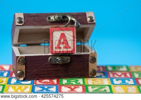Capital Letter A In Treasure Box In Blue Background