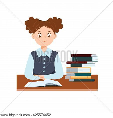 A Cute Schoolgirl Is Sitting At Her Desk. There Are Books On The Table. The Book Is Open. Hands Are