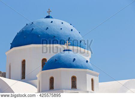 Typical blue dome church on Santorini island, Greece