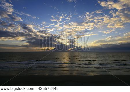 This Cloudy Sunrise Over The Atlantic Ocean Show Clouds Moving In Slow Motion During The Exposure.