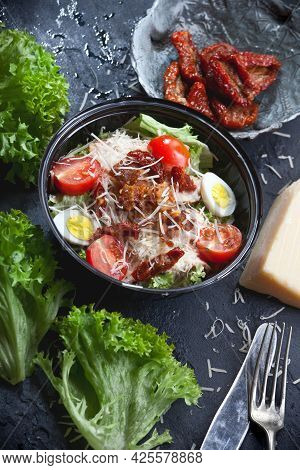 Fresh Caesar Salad With Lettuce Leaves, Fresh And Dry Cherry Tomatoes, Grated Parmesan Cheese, Eggs,
