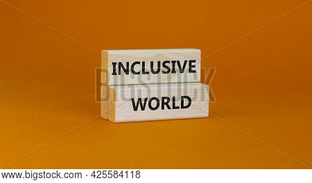 Inclusive World Symbol. Wooden Blocks With Words Inclusive World On Beautiful Orange Background. Bus
