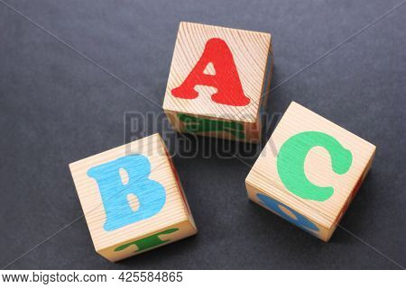 Abc -the First Letters Of The English Alphabet On Wooden Toy Blocks.