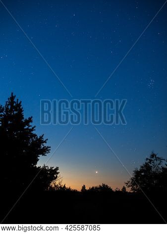 Starry Sky With A Comet And Other Celestial Bodies On The Background Of The Horizon With Silhouettes