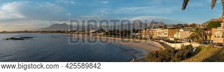 Gordons Bay, South Africa - April 12, 2021: Panoramic Sunset View Of The Beach In Gordons Bay In The