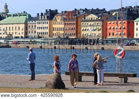 Stockholm, Sweden - August 24, 2018: Tourists Visit Waterfront In Skeppsholmen Island, Stockholm, Sw