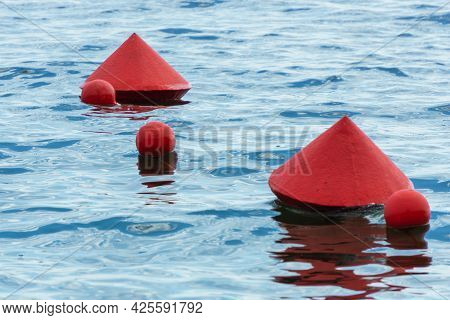 Red Buoys On The Water Surface. Buoys Warning Of Danger At Sea.