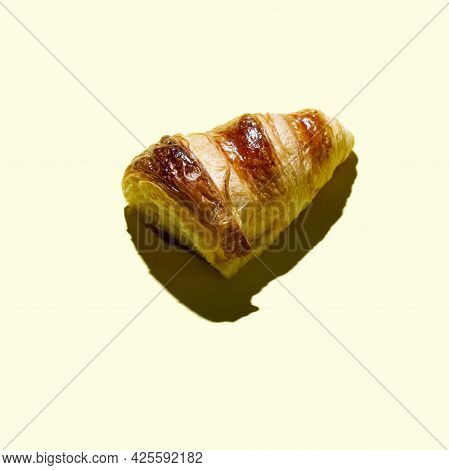 Bakery Products Baked Cutted Croissant  At Minimal Yellow Background. Delicious And Food Concept.