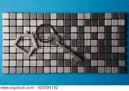 house shaped keyring on stainless steel tiles