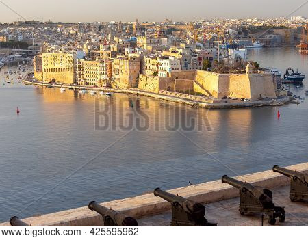 Malta. Aerial View Of The Old Town And The Bay On A Sunny Morning.