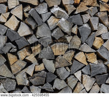 Close Up Stack Of Dry Firewood Oak Wooden Logs, Chopped, Split And Organized In A Pile For Winter Fu