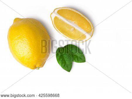 Ripe Juicy Whole Lemon And Lemon Slices Isolated On White Background, Top View. Fresh Fruits.