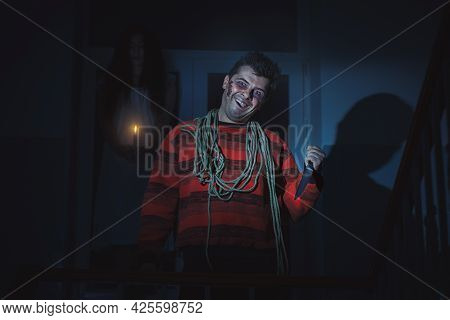 Man Is A Maniac With A Knife In His Hand, Behind Him Is The Ghost Of A Woman.