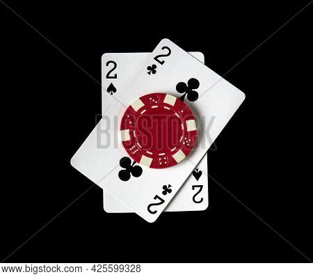 Poker Game With One Pair Combination. Chips And Cards On The Black Table In Poker Club