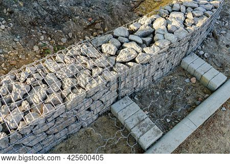 Unfinished Gabion Fence Wall Construction From Steel Mesh With Stones