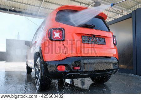 Car Wash With High Pressure Water. Car In Foam, Car Wash