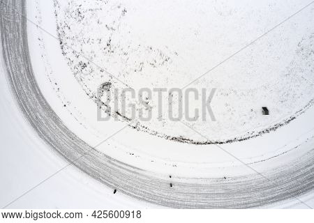 Top View Of A Snow-covered Stadium With A Running Track And A Playing Field Under The Snow. Shooting
