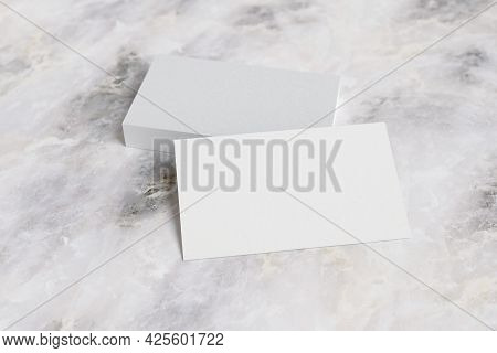 Business Cards On Marble Surface. 3d Illustraton.