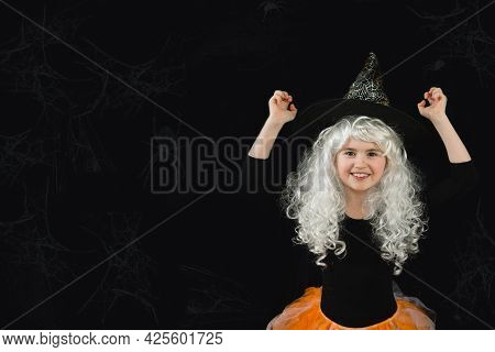 A Cheerful Girl In A White Wig And A Witch Costume On A Black Background With Spiders. Funny Horror.