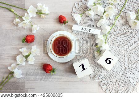 Calendar For July 16 : Cubes With The Number 16, The Name Of The Month Of July In English, A Cup Of