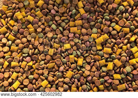 Dry Food For Cats And Dogs Close - Up-a Background Of Round Pellets And Pillows With A Soft Filling-