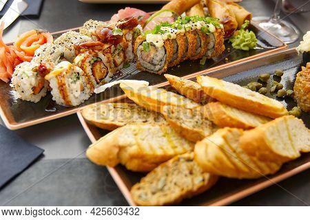 Sushi Set With Fried Baguette. Eating Sushi At Sushi Restaurant