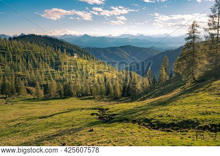 Nice Sunset In The Vast Alpine Valley Under The Hoher Dachstein Massif On A Summer Day With A Hut In