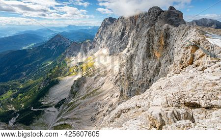 View Of Hoher Dachstein From Skywalk, Or Honerkogel, On A Sunny Summer Day. Tall, Rocky Alpine Peaks