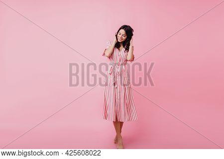 Shy Brunette Girl In Vintage Dress Posing On Pink Background. Photo Of Adorable Latin Female Model I