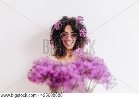 Studio Photo Of Spectacular Black Girl Isolated On Light Background With Bouquet. Indoor Portrait Of