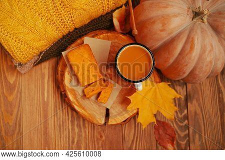 Wooden Tray With Bakery Product And Juice In A Tin Cup. Top View Of An Autumn Composition With An Or