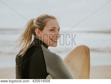 Happy surfer at the beach