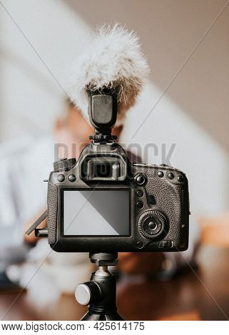 Digital camera with a microphone windshield