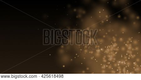 Glowing brown particles effervescing on a dark background. light, colour, energy and movement concept, digitally generated image.