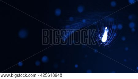 Glowing blue beams of light curving on black background with defocussed blue spots. lght, colour, energy and movement concept, digitally generated image.