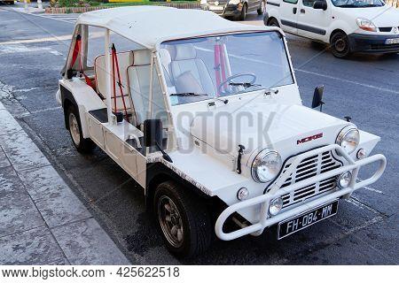Sète , Ocitanie France  - 06 30 2021 : Mini Moke Car Beach By Austin Mini Utility Vehicle Side View